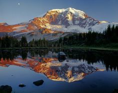 We finish our tour of amazing public lands in the Pacific Northwest with Mount Rainier National Park. At more than 14,000 feet, Mount Rainier stands as an icon in the Washington landscape, while the wildflower meadows and forests that ring the peak offers visitors a great place to explore. This beautiful shot of Mount Rainier – showing a sunset reflection in a lake – was taken from the north side of the peak along the Moraine Park Trail. Photo courtesy of Ed Cooper.