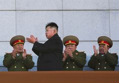 New North Korean leader Kim Jong Un, second from left, applauds as he leaves the stands at Kumsusan Memorial Palace in Pyongyang after reviewing a parade of thousands of soldiers and commemorating the 70th birthday of the late Kim Jong Il on Feb. 16, 2012. (David Guttenfelder / AP)