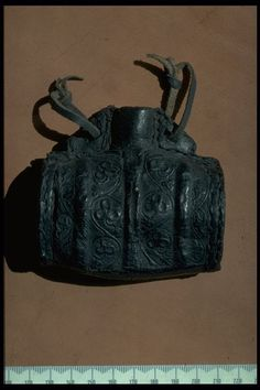 "Leather costrel, decorated with a leaf pattern, 15th century. Soaked in water, leather could be shaped around a pattern or 'former' to make bottles or 'costrels' like this. They were unbreakable and light, ideal for carrying drink on a journey. As the medieval poet Geoffrey Chaucer wrote 'therewithall a costrel taketh he, And said ""hereof a draught or two or three""'. Mystery of History Volume 2, Lesson 79 #MOHII79"