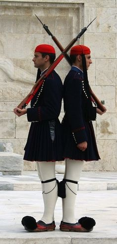 What are these men guarding? Why are they dressed so different? Look at their shoes  Presidential Guard, Athens. Tips for things to do in Athens.