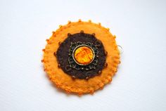 Dragon's Eye  hand embroidered felt earrings by grabacoffee, $13.00
