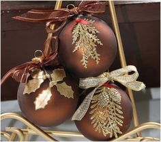 Handmade Christmas ornaments. Looks like dried leaves painted gold and decoupaged on.