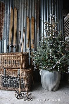 """""""Industrial Farmhouse"""" Decorations w/ Vintage Skis & baskets against corrugated metal wall"""