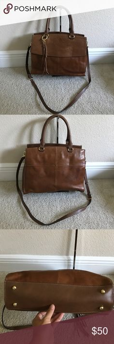"""Tignanello Vintage Leather Convertible Satchel Preowned. Color walnut. Has some scuff/scratches front and back of purse. Top entry, bridge with magnetic snap closure, double roll handles, removable and adjustable crossbody strap, goldtone hardware. Measures approximately 10-1/2""""H x 13""""W x 5-1/2""""D with a 5-1/2"""" handle drop and an 18-1/4"""" to 22-1/4"""" strap drop; weighs approximately 2 lbs, 8 oz Body 100% leather; trim 100% man-made materials; lining 100% polyester Tignanello Bags Satchels"""