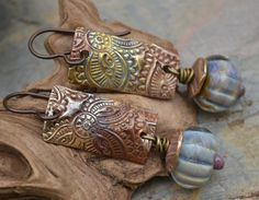 Kristi Bowman's Etsy Shop $45 Copper w/lampwork beads by Lara Lutrick.  the heat treatment on the copper is perfect.