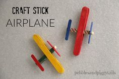 How to make a craft stick airplane using popsicle sticks and clothes pins. Easy airplane craft for kids to make. Also, how we used these airplane crafts to make craft kits for charity and our local children's hospital. Great Christmas service project for kids.