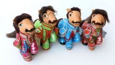 Yoko Pony. Here are the Fab Four in their uniforms for the cover of Sgt. Pepper's Lonely Hearts Club Band. From left to right: Ringo Starr, John Lennon, Paul McCartney and George Harrison.