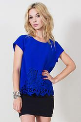 Half Bitten Top: We are amazed by this cobalt blue top with a crochet detail in the front. Features a unique detail in the back with a sheer underlay.