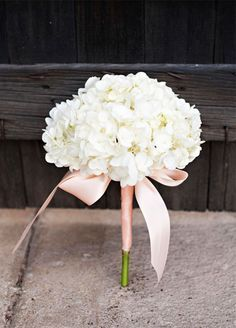 11 Remarkable Single-Flower Wedding Bouquets: One hydrangea stem packs a powerful punch! Adding an elegant and colorful ribbon highlights the soft petals on these fragrant flowers.