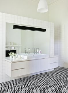 Our windmill pattern geometric triangle floor tiles, create a stunning look to bathroom.