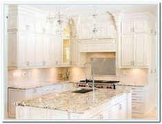 Image result for Granite Counter White Cabinets
