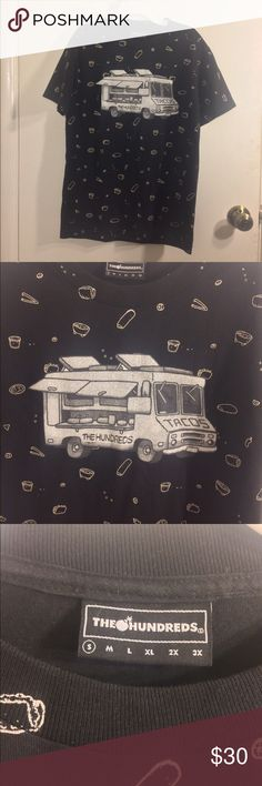 The Hundreds  Taco Truck Shirt The Hundreds men's size small black short sleeve crew neck graphic t-shirt with a taco truck in the center of the front side and little icons (tacos, burritos, guacomole, etc) printed all over the front and back in a scattered layout. The Hundreds Shirts Tees - Short Sleeve