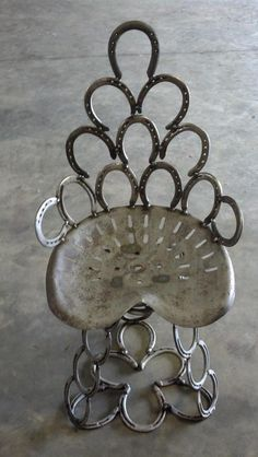 This is a really unique way to recycle old horseshoes and farm equipment! It is a great way to add a country/farm touch to your home that everyone will want to set in!