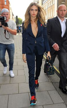 Cara Delevingne from Stars at London Fashion Week Spring 2015  Cara D steps out sans undershirt in a razor-sharp navy suit and sneakers combo.
