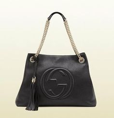 Gucci Soho Leather With Gold Hardware Hobo Bag. Hobo bags are hot this season! The Gucci Soho Leather With Gold Hardware Hobo Bag is a top 10 member favorite on Tradesy. Black Leather Tote, Leather Chain, Leather Shoulder Bag, Leather Tassel, Shoulder Straps, Pink Leather, Gucci Purses, Gucci Handbags, Leather Handbags