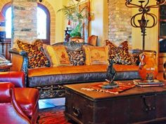 carved wood sofa with leopard hairhide... OOMMMGGG..im in love with this couch and pillows!!!!!!!!!
