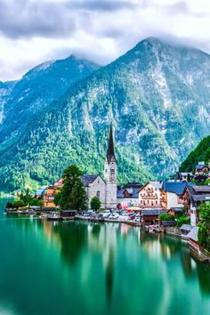 """Now known as the """"most photographed place in Europe,"""" the lakeside town dates back to the Iron Age. Travelers could only access it by boat or narrow trails until the late 19th century."""