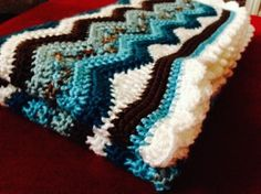 Lovely ripple blanket with shell edging - blanket pattern found at www.babywagz.etsy... #baby #nursery #crochet #pattern #blanket #ripple