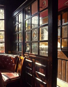 I love the pubs in England and Ireland. I really want a kitchen and dining area that look like the interior of one. Warm, dark, and lots of stained wood.  London Pub interior (don photo)