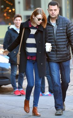 The 25-year-old Help actress wore a navy blue pea coat over a blue and white striped sweater and plaid top, skinny jeans and boots. She accessorized with sunglasses and a beige purse.