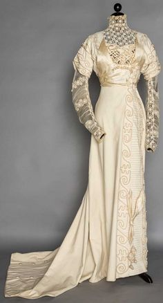 CREAM WOOL EVENING/WEDDING GOWN, 1908                                                                                                                                                                                 More
