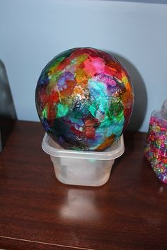 """Paper Mache"" balloons. Tissue paper, glue, sponge-style paint brushes (or any big paint brush), ballons, containers to hold them in.  A few kids to a baloon would work."