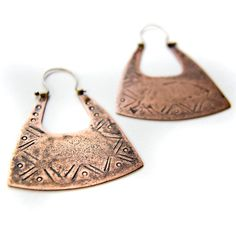 This pair of mixed metal earrings have sterling silver earwires. I have made this pair of earrings that reminds the pieces that made old