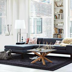Grey sofa, white walls, white lampshade, this room