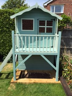 Turquoise blue painted Waltons Honeypot Poppy Tower Playhouse created by our customer Chris. The storage shed underneath adds that extra space and we just love the colours that Chris has chosen here