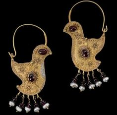 """virtual-artifacts: """" A pair of gold hoop earrings in the form of birds, with hook and eye clasp, each with garnet set to body and eye, with granluated decoration in the form of sunbursts, a series..."""