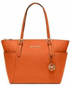 Orange saffiano leather tote with golden hardware. Two slip exterior side pockets. Khaki fabric logo print lining. One zip and four slip interi Michael Kors Jet Set, Michael Kors Outlet, Michael Kors Tote, Handbags Michael Kors, New Handbags, Tote Handbags, Leather Handbags, Fashion Handbags, Orange Purse