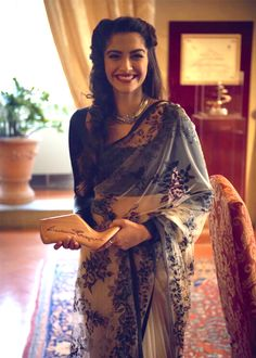 Love the sari. Love her style.