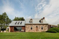Modern redesign of this old country house and a beautiful addition of contemporary architectural elements to the rustic home created beautiful living spaces that are stylish, comfortable and bright