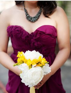 I love the contrast of the bright yellow with the white peonies in this bridal bouquet.