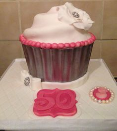 Vintage themed 50th birthday giant cupcake with ruffle flower, bow, cameo brooch and hand cut '50'