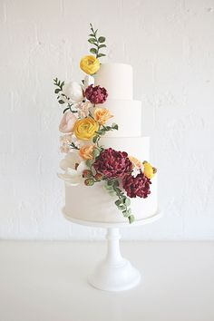 Gorgeous wedding cake with cascading sugar flowers | by Sweet Bloom Cakes