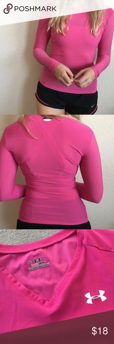 Under Armour long sleeve workout shirt Hot pink workout shirt. Fitted. Part of their heat gear collection that keeps you cool. Perfect for running. Worn a few times, just making room for new clothes. Under Armour Tops Tank Tops