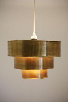 uo brass tiered pendant.