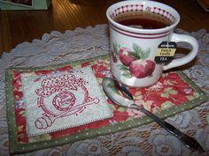 am having a nice cup of tea and enjoying my new Mug Rug!