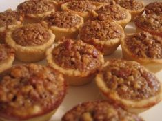 Mini pecan tarts are a bite-sized version of the classic pecan pie (courtesy of my mother-in-law). The dough is simple to make and the filling is rich in flavor. This recipe's simplicity makes it the perfect addition to your baby or wedding shower treats. Mini Pecan Pies, Pecan Tarts, Mini Pies, Pie Recipes, Real Food Recipes, Cookie Recipes, Recipies, Pecan Recipes, Cookie Ideas