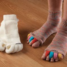 Happy Feet Socks...Think of them as antidotes to high heels, sport strain, and everyday foot stress. Simply by aligning your toes into the proper position, these socks prevent and relieve many common foot problems: bunion pain, plantar fasciitis, hammer toes, and everyday tired feet. Wear them while relaxing at home, or sleep in them and wake up feeling great.