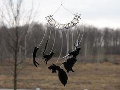 Wind Chime Diy tutorial using #6 plastic. Great craft for adults and kids.