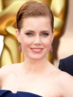 Amy Adams – navy blue strapless Gucci Premiere dress, Christian Louboutin shoes, Tiffany & Co. clutch and jewely