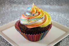 Funky Cupcake by Brenna Hawley: Made by painting a piping bag with stripes of gel food coloring before adding the icing and finished with edible multicolored glitter. #Cupcake #Brenna_Hawley
