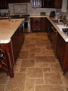 use of Travertine tile. This Versailles pattern adds a warm European flare to this traditional style kitchen. Kitchen Redo, Kitchen Tiles, Kitchen Flooring, Kitchen Styling, Kitchen Countertops, New Kitchen, Warm Kitchen, Tile Flooring, Flooring Ideas