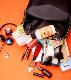 Abigail Spencer keeps an EMK Placental Anti-Aging mask, Frends over-the-ear headphones, Gum SoftPicks, and Koh Gen Do moisture foundation in her backpack. Find out what else is in her bag!