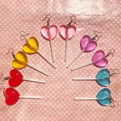 Kawaii heart shaped lollipop earrings Choice of 6 colours! On actual lollipop sticks! Clear coloured resin that glows in the light Hung from silver plated hooks Super cute! Kawaii Accessories, Kawaii Jewelry, Cute Jewelry, Jewelry Accessories, Funky Earrings, Vintage Earrings, Drop Earrings, Accesorios Casual, Aesthetic Fashion