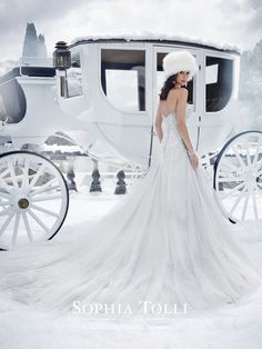 Sophia Tolli | Style No. › Y21521 | Shimmering in the glow of winter's frost, strapless sweetheart Danni showcases sparkling crystal hand-beading that cascades down into a full A-line skirt of misty tulle layers. A chapel length train and back corset complete this glamorous look. Removable spaghetti and halter straps included. Sizes: 0 – 28
