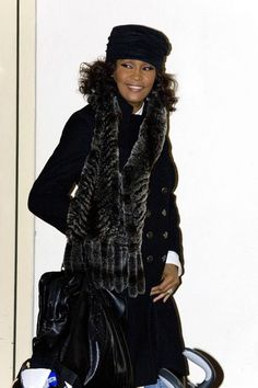 """Whitney Houston Photos - Whitney Houston is all smiles as she waves to the crowd as she leaves """"The X Factor"""" Finals at Fountain Studios in Wembley, headed for the airport. The legendary singer, performed live on UK television for the first time in 12 years. - Simon Cowell leaves Fountain Studios"""