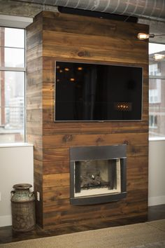 Reclaimed cedar planks from the farm shed encase the living room gas fireplace.